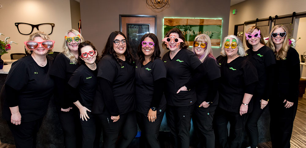 Brady Bunch style photo collage of the staff at Evergreen Eye Care